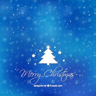 Fond bleu bokeh avec arbre de Noël