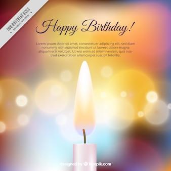 Fond Brillant avec la bougie d'anniversaire et l'effet bokeh