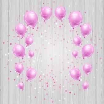 Fond Célébration avec des ballons roses et des confettis sur un fond en bois