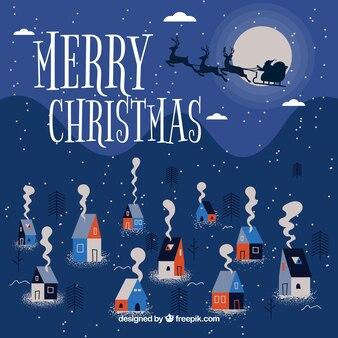 Fond de joyeux Noël avec joli village et le père Noël