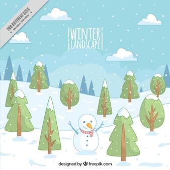 Fond de la forêt avec bonhomme de neige tiré par la main
