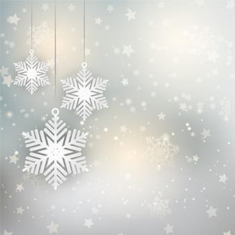 Fond de Noël avec des flocons de neige et les étoiles