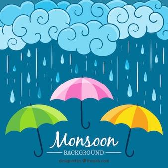 Fond de pluie avec trois parapluies colorés