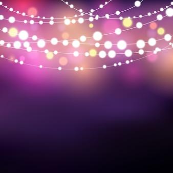 Fond décoratif avec des feux de cordes lumineuses