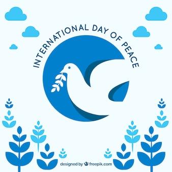 Fond décoratif avec le jour du pigeon et des feuilles de la paix