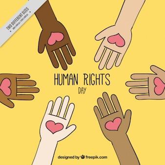 Fond jaune pour la journée des droits de l'homme avec les mains tenant les coeurs