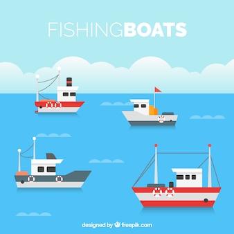 Fond plat avec quatre bateaux de pêche