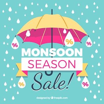 Fond vintage de vente de mousson avec un parapluie et des gouttes