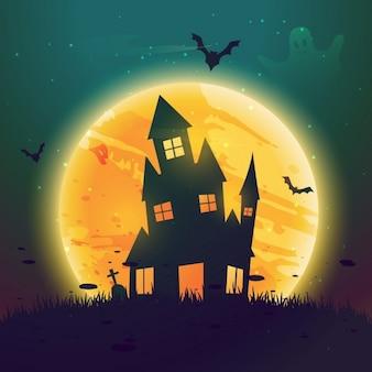 Hause hantée d'Halloween en face de la lune