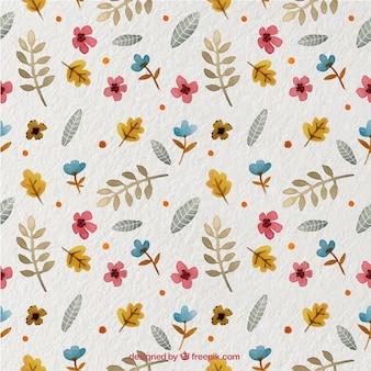 Joli motif avec des plantes et des fleurs à l'aquarelle