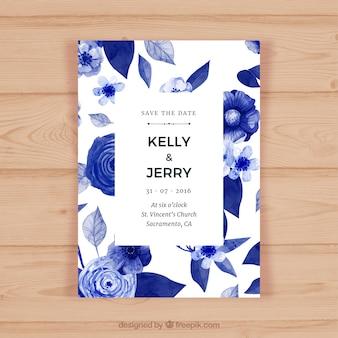 Jolie carte de mariage avec des fleurs aux tons bleus
