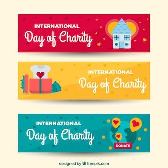 Journée de la charité de trois bannières avec des éléments en conception plate