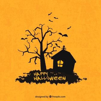 Joyeux fond d'Halloween avec la silhouette de la maison et de l'arbre