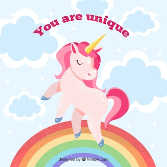 """L'arrière-plan de la licorne avec l'arc-en-ciel et le message """"vous êtes unique"""""""