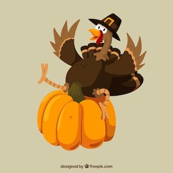 La dinde de Thanksgiving drôle et une citrouille
