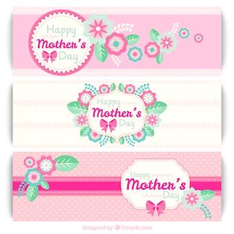 Les bannières de fête des mères rose avec des fleurs