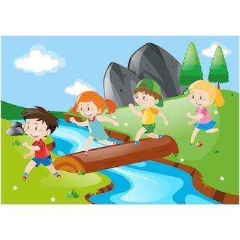 Les enfants traversant une rivière