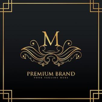 Logo de la marque élégante concept de prime d'or faite avec style floral