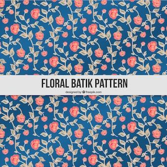 Main batik dessiné motif floral