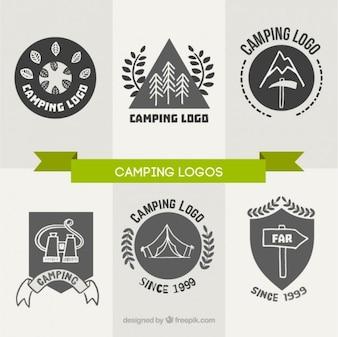 Main dessiné logos de camping