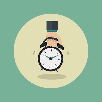 Main tenant l'icône de l'horloge