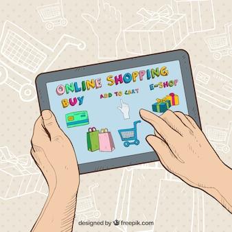 Mains achetant en ligne avec tablette