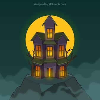 Maison effrayante avec pleine lune