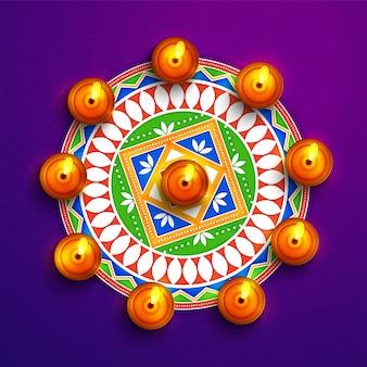 Mandala floral coloré avec des lampes à huile pour Diwali.