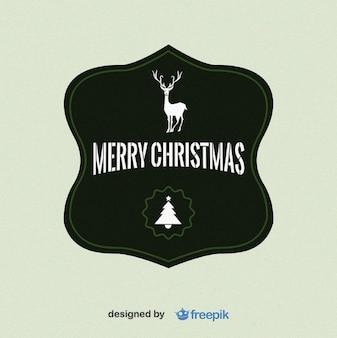 Merry Christmas label avec un cerf dans l'arbre supérieur et de Noël dans le fond