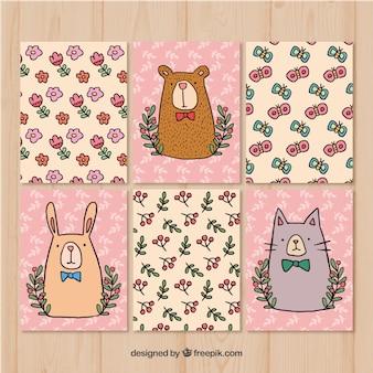 Mignon pack de cartes avec des animaux et des fleurs
