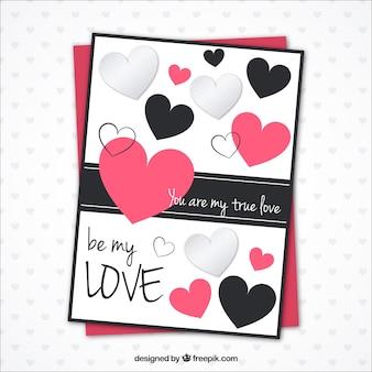 Modèle de carte romantique avec des coeurs décoratifs