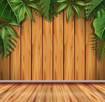 Modèle de fond avec des feuilles vertes sur un mur en bois