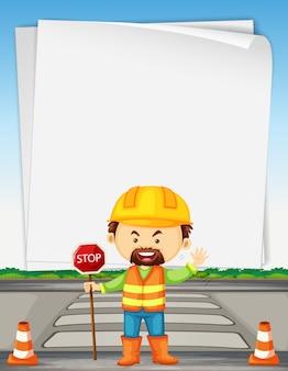 Modèle de papier avec un travailleur routier sur la route