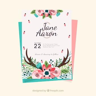 Modèle floral d'invitation de mariage en style dessiné à la main