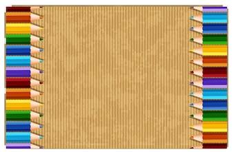 Papier en carton avec crayons de couleur à gauche et à droite