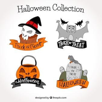 Paquet à la main d'étiquettes halloween