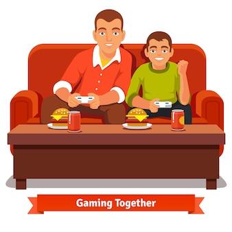 Père et fils jouant aux jeux vidéos