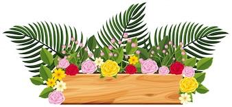 Planche de bois avec des roses et des feuilles sur le dessus