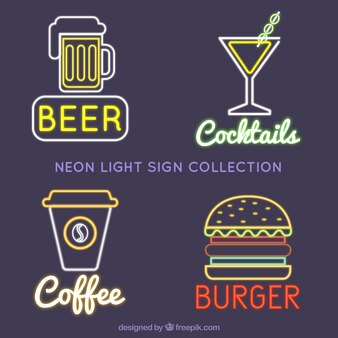 Quatre enseignes lumineuses au néon