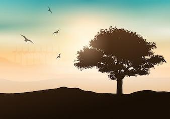 Silhouette d'un arbre contre un fond du coucher du soleil avec des éoliennes
