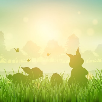 Silhouette des lapins de Pâques dans un paysage herbeux