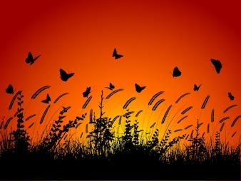 Silhouette des papillons qui volent entre le blé et le feuillage