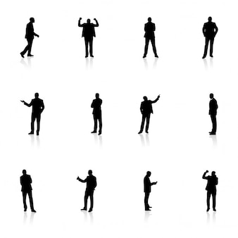 Silhouettes d'affaires dans diverses poses