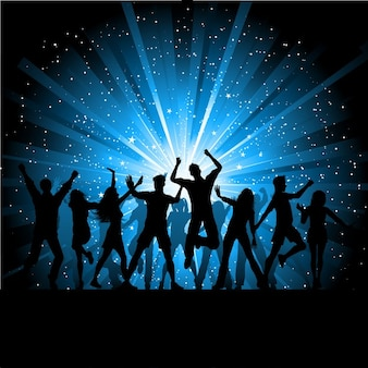 Silhouettes de gens qui dansent sur fond étoilé