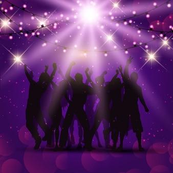 Silhouettes de gens qui dansent sur un fond de Noël