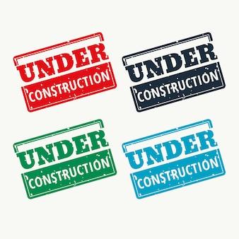 Sous construction signe vecteur en quatre couleurs