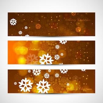 Têtes de noël d'or avec des flocons de neige