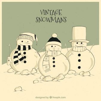 Tiré par la main carte de bonhommes de neige cru