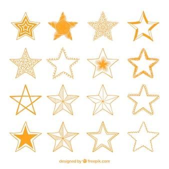 Variété d'étoiles dorées dessinées à la main