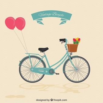 Vélo vintage avec des ballons